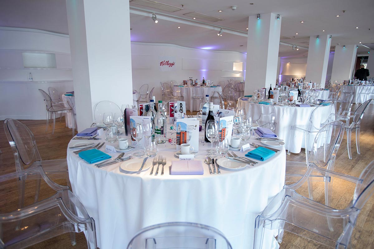 tables and chairs for event catering services by corporate event planner