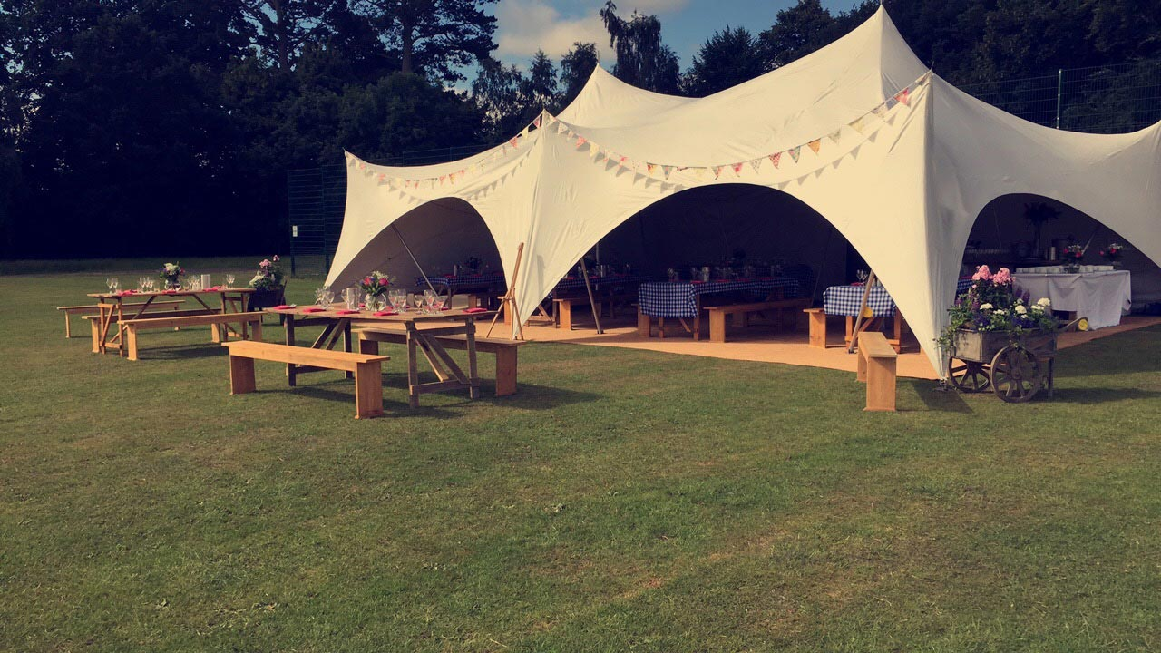 marquee with tables set by bespoke event planning company